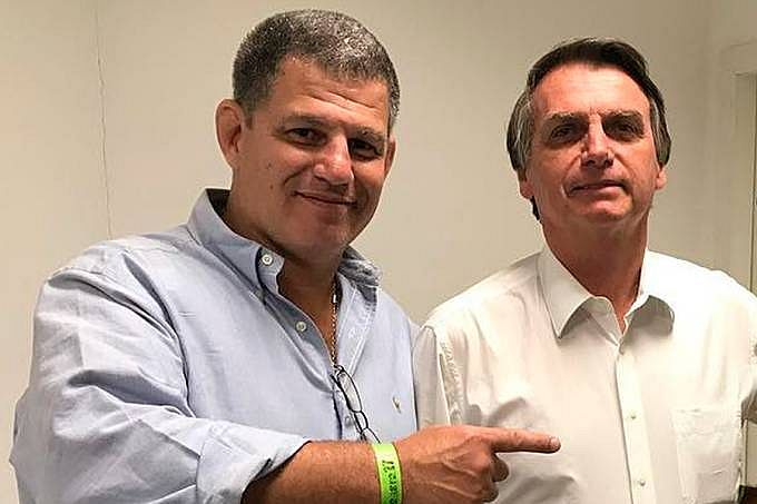 O agora ex-ministro Gustavo Bebianno e o presidente Jair Bolsonaro